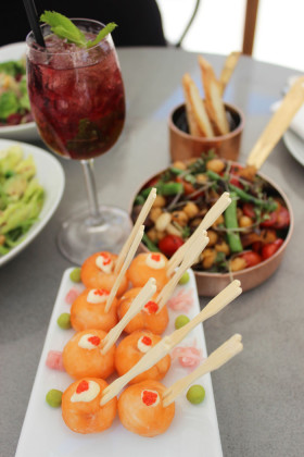 A-selection-of-summery-tapas-with-salmon-sushi-balls-front-and-centre---Photos-by-Allison-Foat