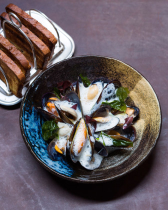 chardonnay-steamed-west-coast-mussels-with-celeriac-and-ham-hock-veloute-poached-oysters-and-fresh-seaweed