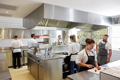 fabers-open-plan-kitchen-shows-chef-eric-bulpitt-far-right-and-his-colleagues-at-work-plating-the-intricate-dishes
